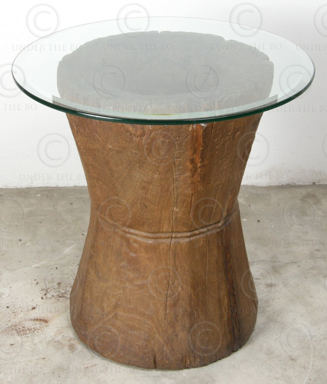 Side table H19B-98. Teakwood curry pounder with glass top. India.